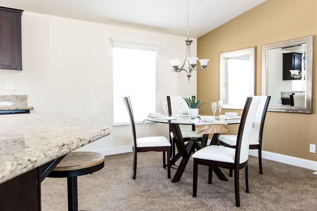The CK522F Dining Area. This Manufactured Mobile Home features 4 bedrooms and 2 baths.