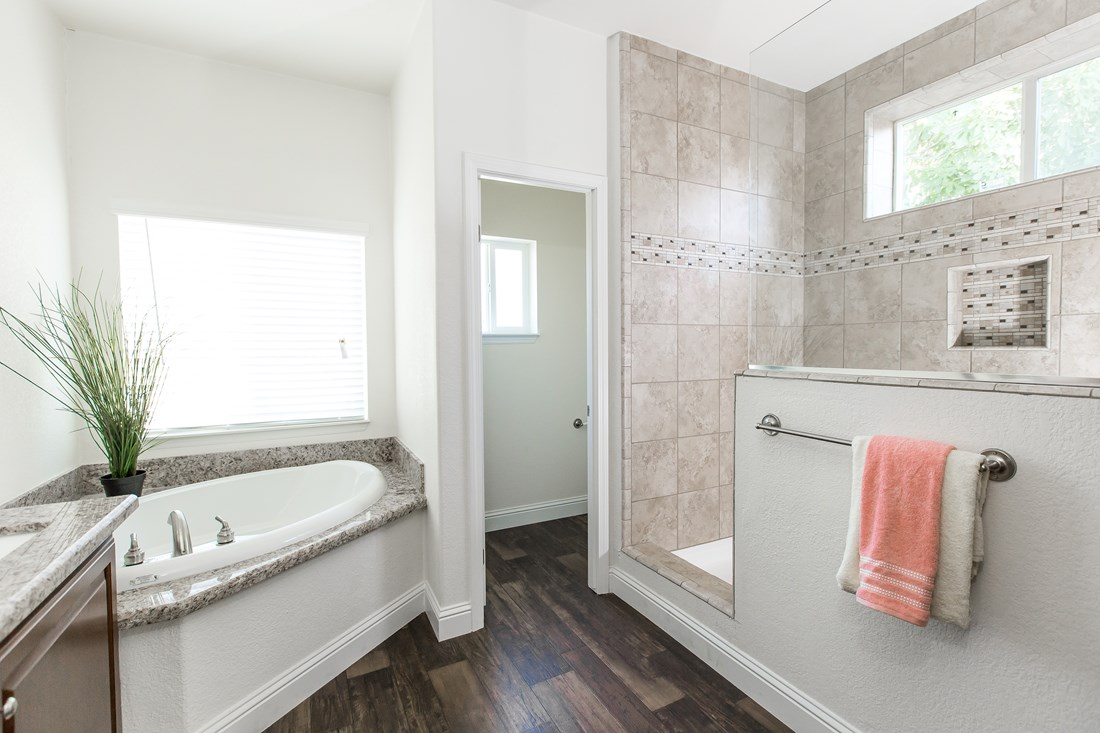The GLE661K Master Bathroom. This Manufactured Mobile Home features 3 bedrooms and 2 baths.